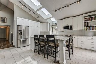 Photo 11: 512 Coach Grove Road SW in Calgary: Coach Hill Detached for sale : MLS®# A1127138