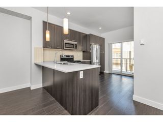 """Photo 2: 81 5888 144 Street in Surrey: Sullivan Station Townhouse for sale in """"One44"""" : MLS®# R2563940"""