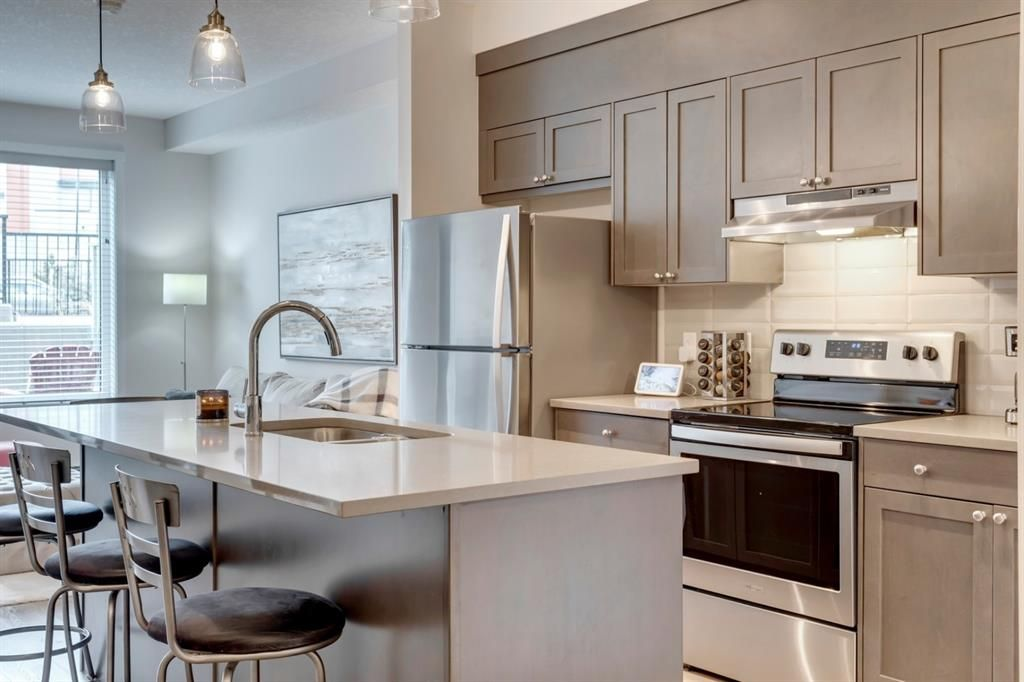 Main Photo: 104 30 Shawnee Common SW in Calgary: Shawnee Slopes Apartment for sale : MLS®# A1099308