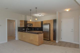 Photo 2: 328 69 Springborough Court SW in Calgary: Springbank Hill Apartment for sale : MLS®# A1124627