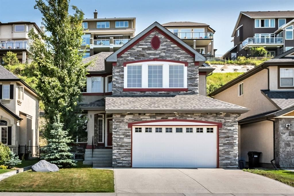 Main Photo: 157 Springbluff Boulevard SW in Calgary: Springbank Hill Detached for sale : MLS®# A1129724