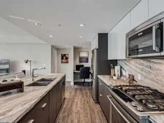 Photo 13: 201 560 6 Avenue SE in Calgary: Downtown East Village Apartment for sale : MLS®# A1084324
