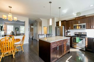 "Photo 8: 6858 208 Street in Langley: Willoughby Heights Condo for sale in ""Mantel At Milner Heights"" : MLS®# R2354680"