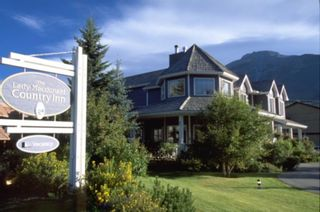 Photo 1: 1201 Bow Valley Trail: Canmore Hotel/Motel for sale : MLS®# A1088274
