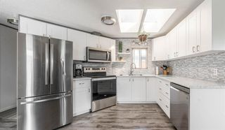 Photo 10: 105 Heritage Drive: Okotoks Mobile for sale : MLS®# A1133143