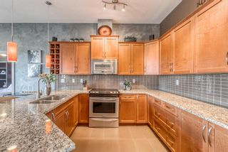 Photo 5: 408 35 Aspenmont Heights SW in Calgary: Aspen Woods Apartment for sale : MLS®# A1149292