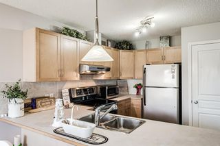 Photo 8: 30 33 Stonegate Drive NW: Airdrie Row/Townhouse for sale : MLS®# A1117438