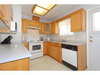 Photo 4: 2765 COAST MERIDIAN Road in Port Coquitlam: Glenwood PQ House for sale : MLS®# V862235