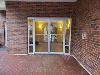 "Photo 4: 105 13883 LAUREL Drive in Surrey: Whalley Condo for sale in ""EMERALD HEIGHTS"" (North Surrey)  : MLS®# R2614070"