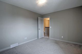 Photo 14: 115 Everhollow Street SW in Calgary: Evergreen Detached for sale : MLS®# A1145858