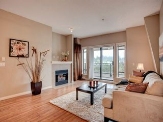 """Photo 1: 411 8880 202 Street in Langley: Walnut Grove Condo for sale in """"RESIDENCE AT VILLAGE SQUARE"""" : MLS®# F1416021"""