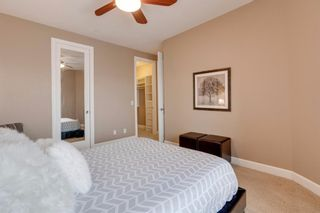 Photo 23: 34 Cougar Ridge Landing SW in Calgary: Cougar Ridge Row/Townhouse for sale : MLS®# A1075174