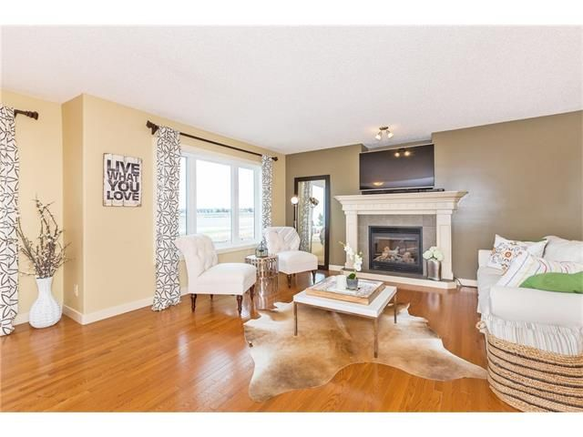 Photo 6: Photos: 664 LUXSTONE Landing SW: Airdrie House for sale : MLS®# C4106944