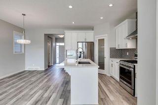Photo 8: 209 Auburn Meadows Place SE in Calgary: Auburn Bay Semi Detached for sale : MLS®# A1072068