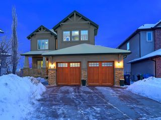 Photo 1: 30 Springborough Crescent SW in Calgary: Springbank Hill Detached for sale : MLS®# A1070980