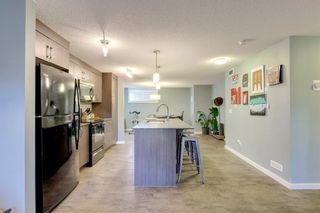 Photo 8: 34 AUBURN BAY Link SE in Calgary: Auburn Bay Row/Townhouse for sale : MLS®# A1027472