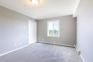 Photo 16: 8329 304 MACKENZIE Way SW: Airdrie Apartment for sale : MLS®# A1128736