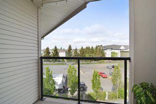 "Photo 13: 406 20239 MICHAUD Crescent in Langley: Langley City Condo for sale in ""City Grande"" : MLS®# R2062935"