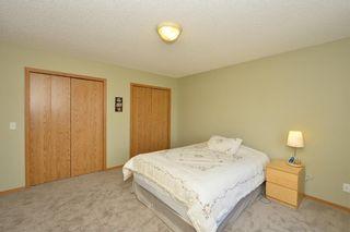 Photo 25: 41 BRIDLERIDGE Gardens SW in Calgary: Bridlewood House for sale : MLS®# C4135340