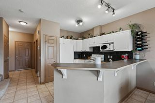 Photo 8: 111 2 Westbury Place SW in Calgary: West Springs Row/Townhouse for sale : MLS®# A1112169