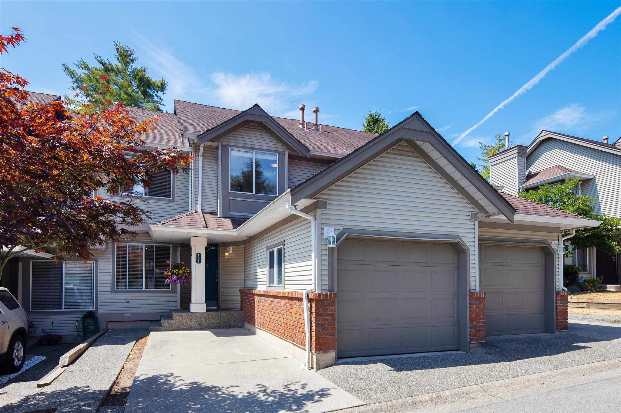 """Main Photo: 405 13900 HYLAND Road in Surrey: East Newton Townhouse for sale in """"HYLAND GROVE"""" : MLS®# R2605860"""