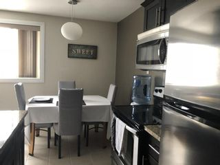 Photo 4: 201 1710 Taylor Avenue in Winnipeg: River Heights Condominium for sale (1D)  : MLS®# 202100212