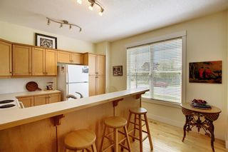 Photo 12: 45 Discovery Heights SW in Calgary: Discovery Ridge Row/Townhouse for sale : MLS®# A1109314