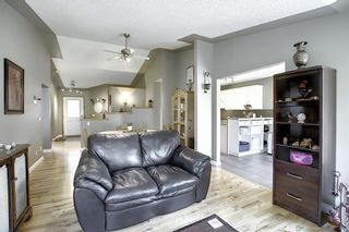 Photo 7: 165 Lakeside Greens Place: Chestermere Semi Detached for sale : MLS®# A1028449