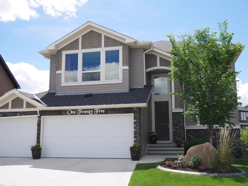 FEATURED LISTING: 125 RAINBOW FALLS Bay Chestermere