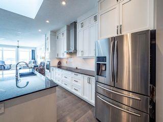Photo 8: 47 Cranarch Terrace SE in Calgary: Cranston Detached for sale : MLS®# A1077265