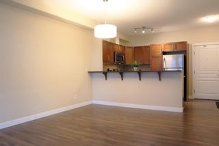 Photo 3: 108 48 Panatella Road NW in Calgary: Panorama Hills Apartment for sale : MLS®# A1063178