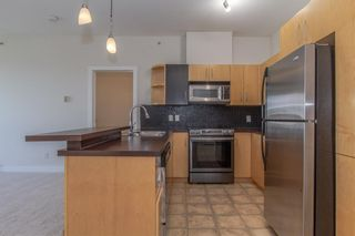 Photo 5: 328 69 Springborough Court SW in Calgary: Springbank Hill Apartment for sale : MLS®# A1124627