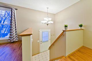 Photo 4: 10 BRIDLEGLEN RD SW in Calgary: Bridlewood House for sale : MLS®# C4291535