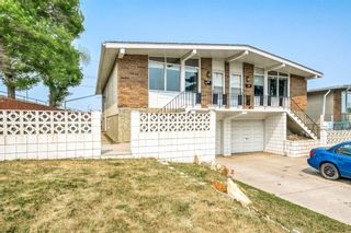 Photo 2: 500 and 502 34 Avenue NE in Calgary: Winston Heights/Mountview Duplex for sale : MLS®# A1135808
