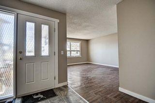 Photo 3: 187 Deerview Way SE in Calgary: Deer Ridge Semi Detached for sale : MLS®# A1096188