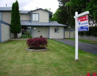 Photo 1: 6941 135TH ST in Surrey: West Newton 1/2 Duplex for sale : MLS®# F2511369