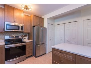 """Photo 10: 102 2733 ATLIN Place in Coquitlam: Coquitlam East Condo for sale in """"ATLIN COURT"""" : MLS®# R2475795"""