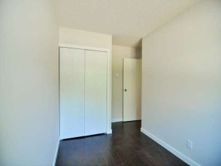 """Photo 12: 887 CUNNINGHAM Lane in Port Moody: North Shore Pt Moody Townhouse for sale in """"WOODSIDE VILLAGE"""" : MLS®# V1021537"""