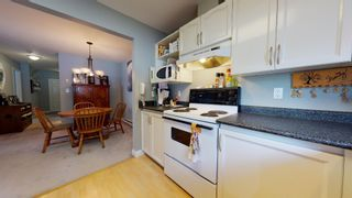 """Photo 6: 105 6440 197 Street in Langley: Willoughby Heights Condo for sale in """"Kingsway"""" : MLS®# R2603548"""