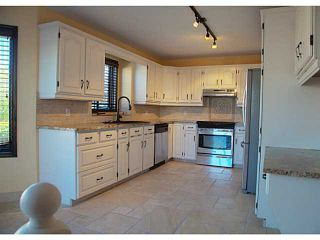 Photo 3: 34 SUNVISTA Crescent SE in Calgary: Sundance Residential Detached Single Family for sale : MLS®# C3636190