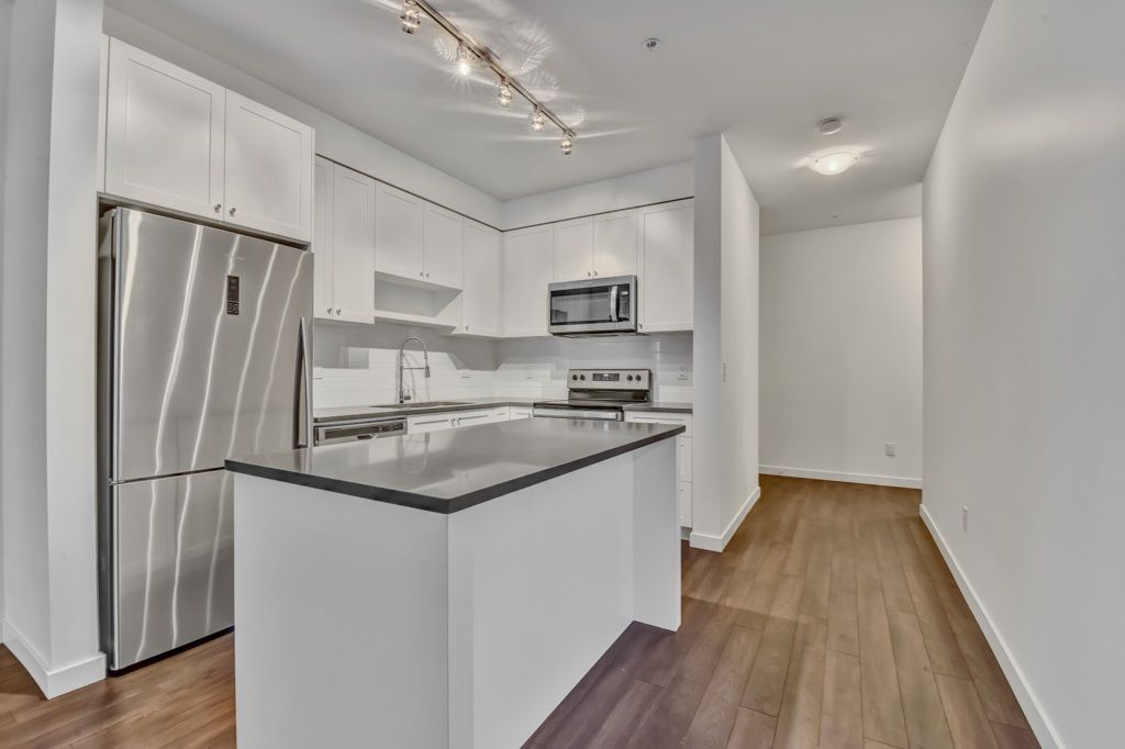 """Main Photo: 201 13628 81A Avenue in Surrey: Bear Creek Green Timbers Condo for sale in """"Kings Landing"""" : MLS®# R2523398"""