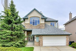 Photo 1: 12 Strathlea Place SW in Calgary: Strathcona Park Detached for sale : MLS®# A1114474