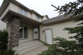 Photo 2: 180 FAIRWAYS Drive NW: Airdrie Residential Detached Single Family for sale : MLS®# C3526868
