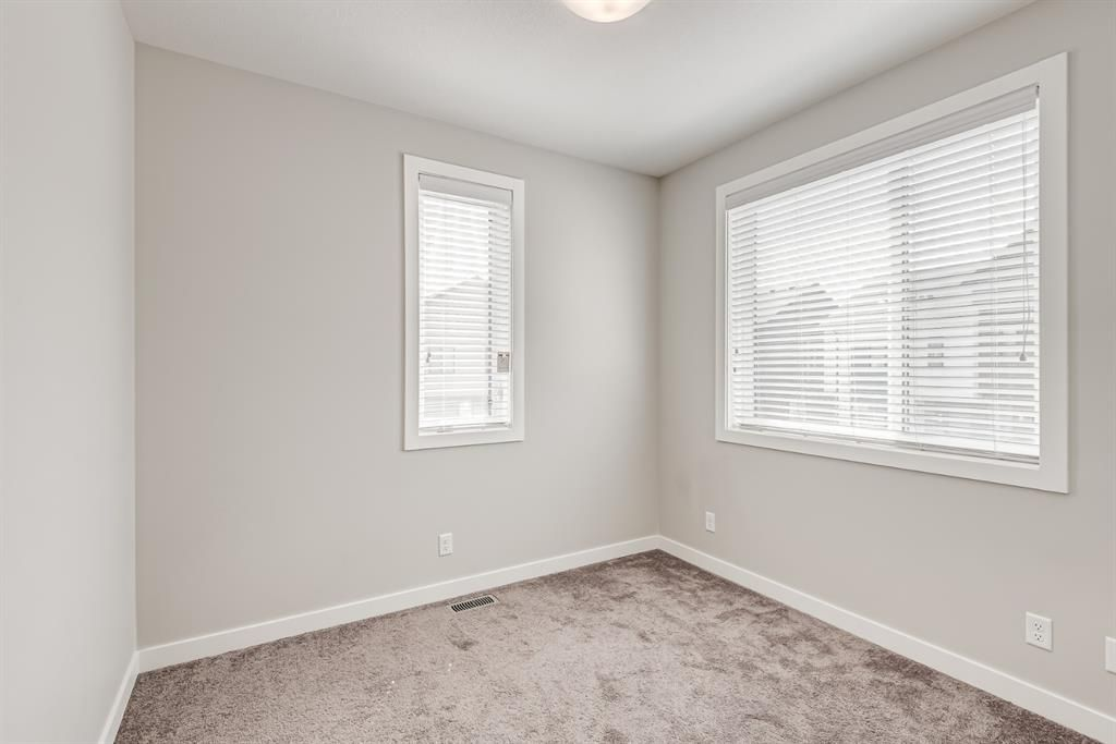 Photo 17: Photos: 125 Redstone Crescent NE in Calgary: Redstone Row/Townhouse for sale : MLS®# A1124721