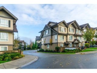 """Photo 1: 21 21867 50 Avenue in Langley: Murrayville Townhouse for sale in """"Winchester"""" : MLS®# R2009721"""