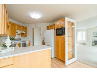 """Photo 5: 204 5375 205 Street in Langley: Langley City Condo for sale in """"Glenmont Park"""" : MLS®# R2500306"""