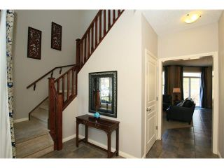 Photo 3: 188 SUNSET Close: Cochrane House for sale : MLS®# C4115906
