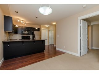 "Photo 3: 218 30515 CARDINAL Avenue in Abbotsford: Abbotsford West Condo for sale in ""Tamarind"" : MLS®# R2333339"