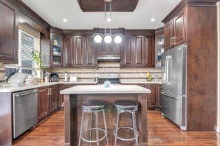 Photo 3: 7032 144 Street in Surrey: East Newton 1/2 Duplex for sale : MLS®# R2578932