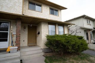 Photo 2: 147 Midbend Place SE in Calgary: Midnapore Row/Townhouse for sale : MLS®# A1041625